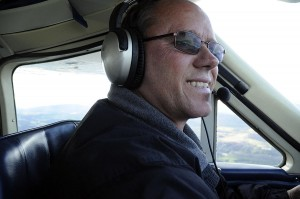 Northeast Kingdom International Airport Manager Dan Gauvin navigates his four-seat Cessna through a stiff crosswind over Coventry and Newport. Gauvin had been running the Newport State Airport for almost decade when, in 2012, developers from Jay Peak took over management of the facility.